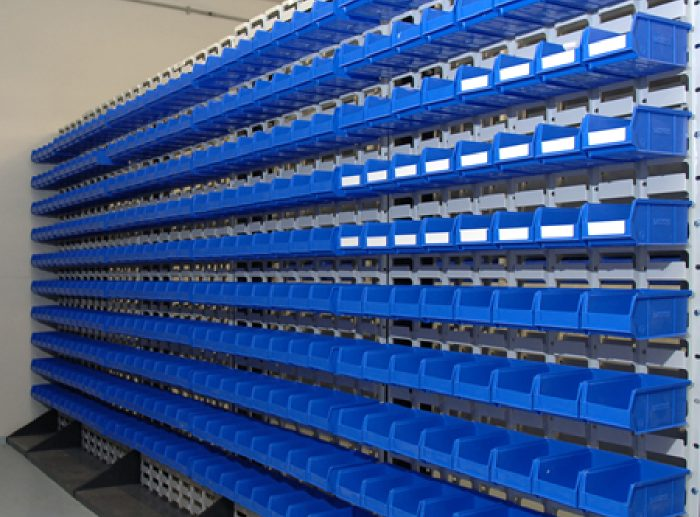 small parts shelving blue cartons
